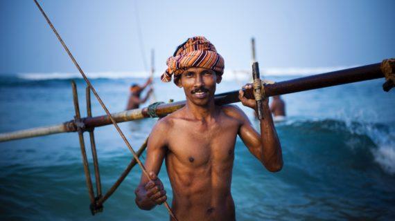 Smiling fisherman.